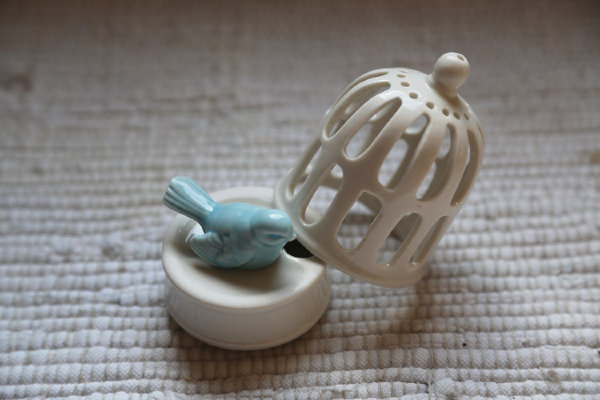 White porcelain cage with bird