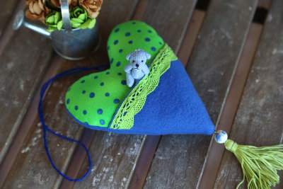 Fabric heart with pocket and miniature bear