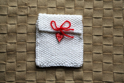 "Knitted gift bag ""White heart"""