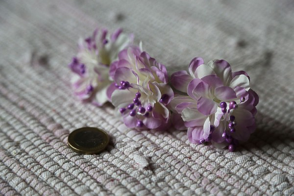 Small violet and white realistic flowers